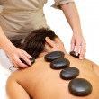 Hot stone massage — Stock Photo