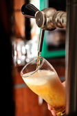 Filling glass in pub — Stock Photo