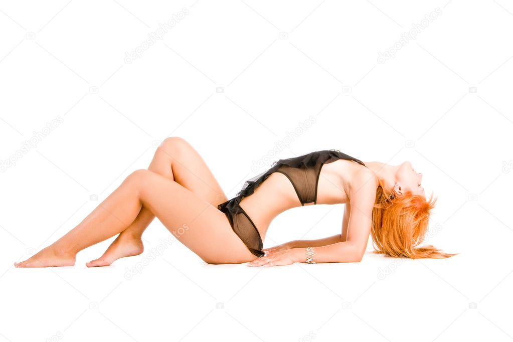 Lying young slim girl in black sexy nightgown — Stock Photo #3164473