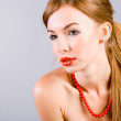 Girl in a red beads — Stock Photo
