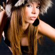 Young girl in fur-cap — Stock Photo
