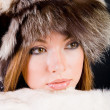 Girl in fur-cap — Stock Photo
