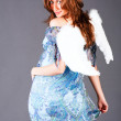 Smiling angel in blue dress — Stock Photo