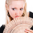 Young beautiful blond girl with a fan — Stock Photo