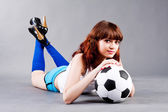 Young girl with a soccer ball — Stock Photo
