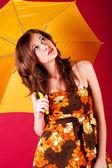 Pretty girl in dress with a umbrella — Stock Photo