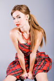 Beautiful young seduce girl in dress — Stock Photo