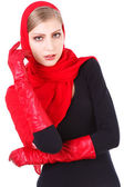 Beautiful charming girl dancing in red gloves — Stock Photo