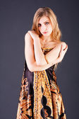 Beautiful alluring blond girl in dress — Stock Photo