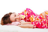 Sweet young girl in pink pajamas on bed — Stock Photo
