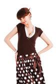 Sweet girl in a polka dot dress — Stock Photo