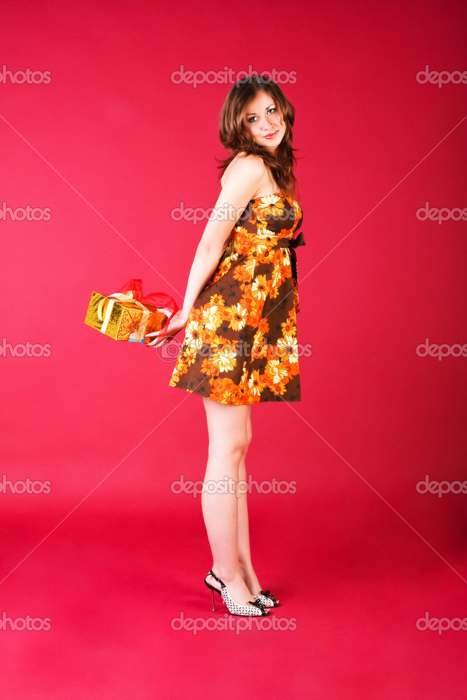 Portrait of a young charming girl with present — Stock Photo #3198587