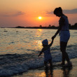 Silhouette of woman and baby — Stock Photo