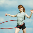 Girl with gymnastic hoop — Stock Photo
