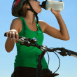Foto Stock: Thirsty bicycler