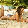 Beautiful young woman relaxing on the beach — Stock Photo