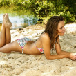 Beautiful young womrelaxing on beach — Stock Photo #3443520
