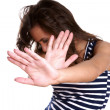 Stock Photo: Young woman making stop gesture