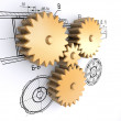Golden gears against a background of engineering drawings — Stock Photo