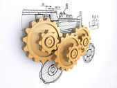 Three golden gears against a background of engineering drawings with shadow — Stock Photo
