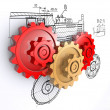 Stock Photo: Two metallic red and one golden gears against a background of engineering