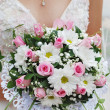The bride holding a bouquet — Stock Photo