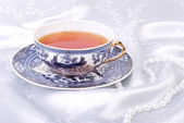 Blue chinese cup with white pearl beads — Stock Photo