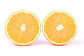 Two slices of oranges in front of the camera — Stock Photo