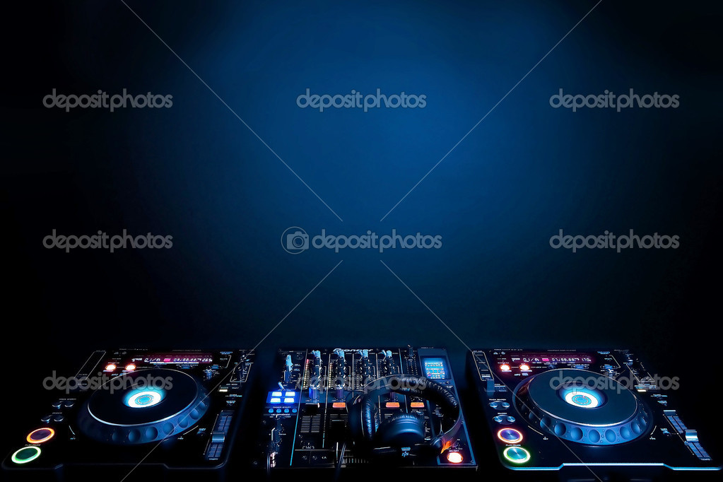 DJ turntables and electronic mixer on blue background  Foto de Stock   #3176864