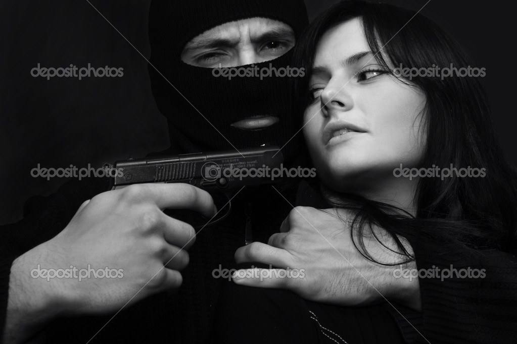 Young beautiful sexy girl in hostages at gangster in mask — Stock Photo #3206327