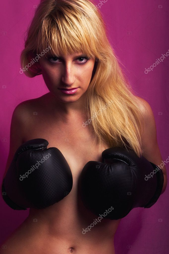 Sexy boxer girl posing with black boxer gloves — Stok fotoğraf #3817013