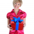Girl with a gift in the hands — Stock Photo #3223249