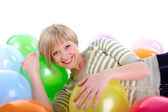 Happy smiling girl with balloons — Stock Photo
