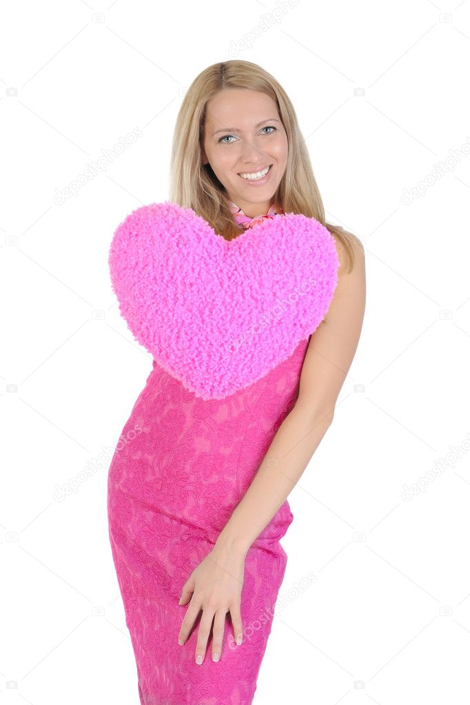 Funny girl in a pink dress holding heart on his outstretched hand. Isolated on white background — Stock Photo #3223295