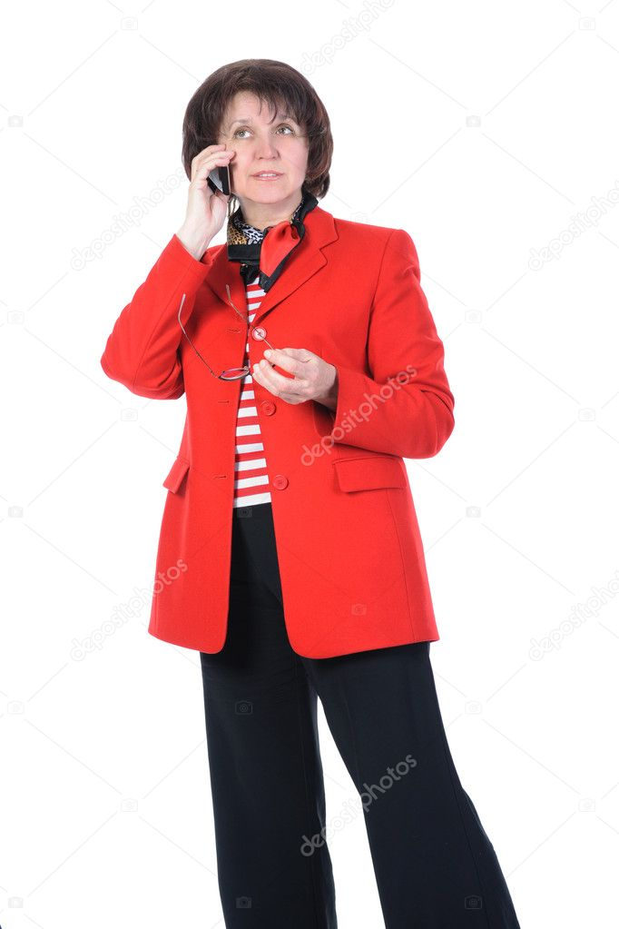 Adult business woman with a phone in a red jacket. Isolated on white background — Stock Photo #3223319