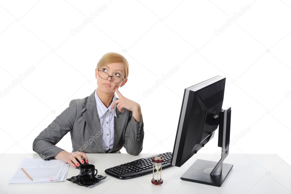 Young beautiful businesswoman on the computer. Isolated on white background. — Stock Photo #3223386