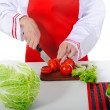 Chef cut the tomatoes - Foto Stock