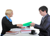 Business partners share the documents. — Stock Photo