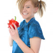 Beautiful smiling girl holding a red pepper. — Stock Photo