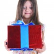 Girl surprised with a gift — Stock Photo #3277260