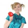 Young smiling girl holding a red pepper. — Stock Photo #3277377