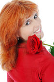 Beautiful red-haired girl with a rose. — Stock Photo