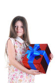 Little girl keep in hands a gift — Stock Photo