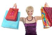 Flicka med kassar och påsar. — Stockfoto