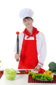 Chef and tomato on the knife. — Stock Photo