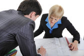 Business partners are considering drawing. — Stock Photo