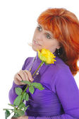 Red-haired woman with a yellow rose. — Stock Photo