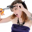 Beautiful young girl does her hair. — Stock Photo