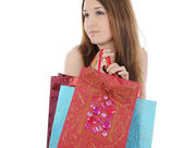 Brunette with a shopping bag. — Stockfoto