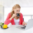 Girl drinking morning coffee in the office. — Stock Photo